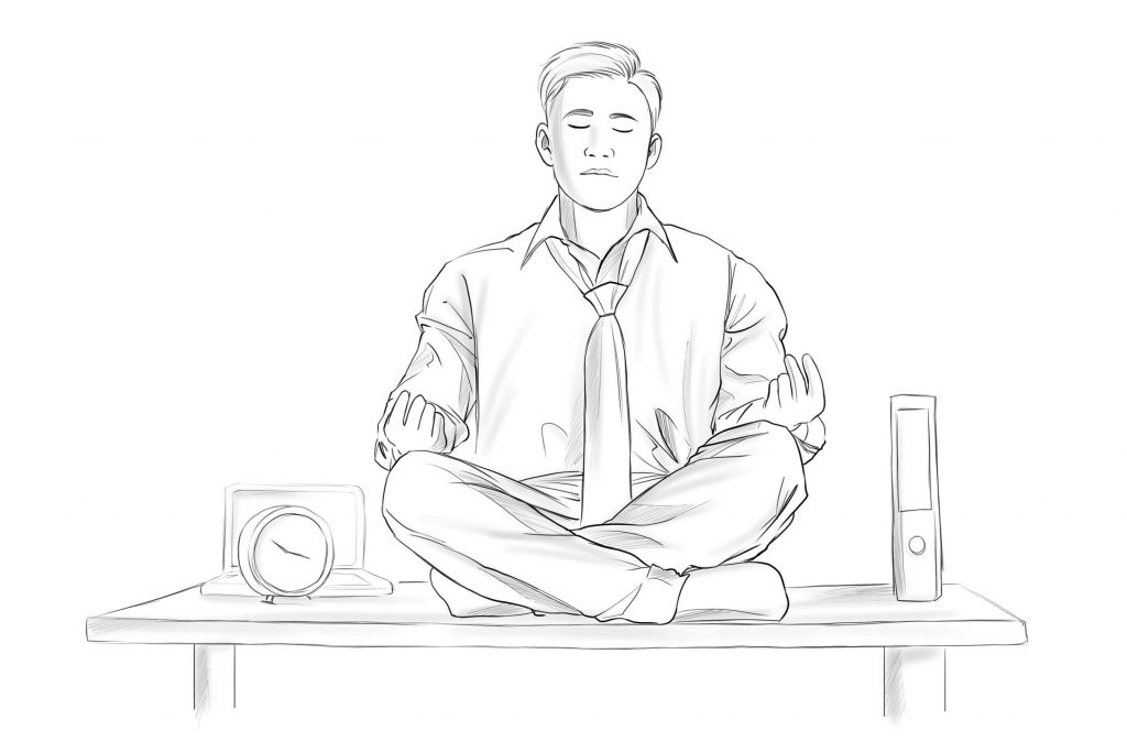 PERSON MEDITATING IN AN OFFICE